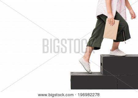 Cropped Shot Of Schoolchild Holding Book Walking On Podium Isolated On White