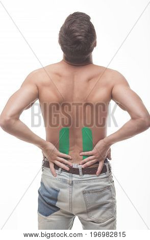 people, health care and problem concept - close up of man suffering from pain in back or reins over white background