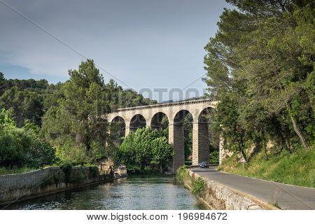 Ancient Galas Aqueduct at Fontaine-de-Vaucluse village. Provence. France