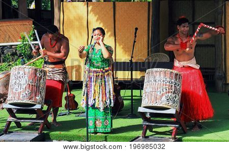 Honolulu Hawaii - May 27 2016: A group of Tongan entertainers perform for audiences at the Polynesian Cultural Center a popular tourist attraction on Oahu.