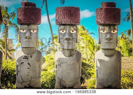 Honolulu Hawaii - May 27 2016: Rapa Nui or Easter Island Moai on display at the Polynesian Cultural Center. Moai are monolithic human figures carved by the Rapa Nui people on Easter Island in eastern Polynesia between 1250 and 1500 A.D.
