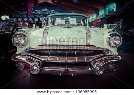 PAAREN IM GLIEN GERMANY - MAY 23 2015: Full-size car Pontiac Chieftain 1956. Stylization. Vintage toning. The oldtimer show in MAFZ.