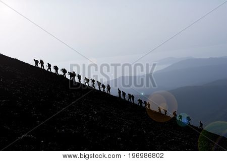 Mountain climbers at the peak of the mountains