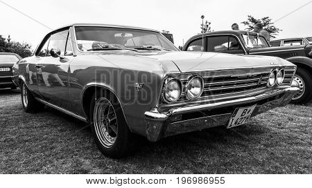 PAAREN IM GLIEN GERMANY - MAY 23 2015: Mid-size car Chevrolet Chevelle (First generation). Black and white. The oldtimer show in MAFZ.