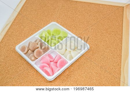 sweet colorful Allure - Thai traditional dessert on white plate with brown background