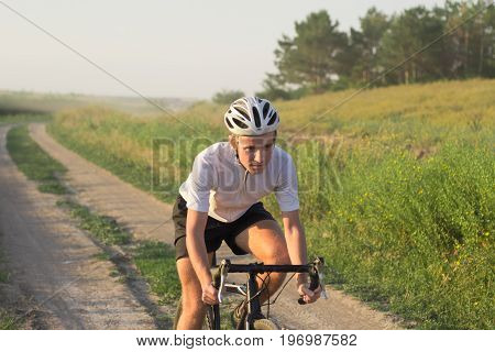 Portrait of bicycle rider on the country road