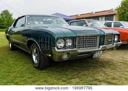 PAAREN IM GLIEN GERMANY - MAY 23 2015: Mid-size car Oldsmobile Cutlass Supreme 1972. The oldtimer show in MAFZ.