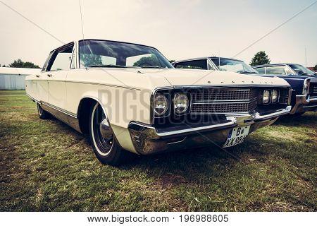 PAAREN IM GLIEN GERMANY - MAY 23 2015: Vintage car Chrysler New Yorker 1965. Stylization. Vintage toning. The oldtimer show in MAFZ.