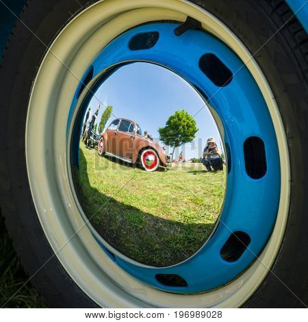 PAAREN IM GLIEN GERMANY - MAY 23 2015: Reflections of an old car in the decorative wheel covers. The oldtimer show in MAFZ.