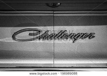 PAAREN IM GLIEN GERMANY - MAY 23 2015: Emblem of a mid-size pony car Dodge Challenger 1974. Black and white. The oldtimer show in MAFZ.