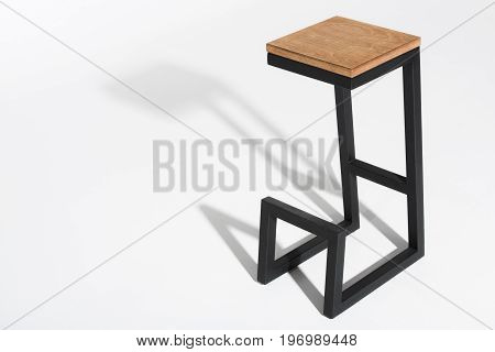 Studio Shot Of Stylish Barstool With Wooden Top And Black Metallic Legs Standing On White