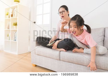 Woman With A Lovely Children Watching Sports Game