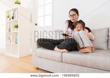 Mother And Daughter Watching Movies With Home Tv