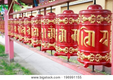 Detail of a Lamaism Datsan temple with red drums in a row