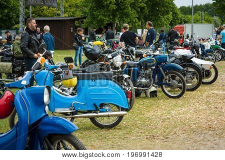PAAREN IM GLIEN GERMANY - MAY 23 2015: Various vintage motorcycles mopeds and scooters on an exhibition field. The oldtimer show in MAFZ.