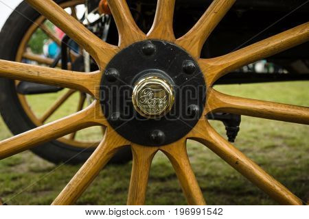 PAAREN IM GLIEN GERMANY - MAY 23 2015: Fragment of an old car wheel Ford A. The oldtimer show in MAFZ.