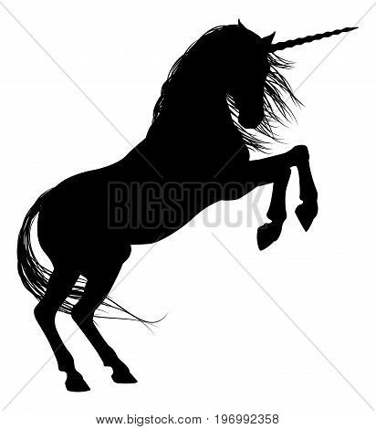 Unicorn mythical horse in silhouette rearing on hind legs