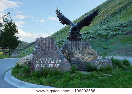 JACKSON HOLE, WYOMING - JUNE 27, 2017:  National Museum of Wildlife Art. Statue at the entrance to the museum dedicate to wildlife art.