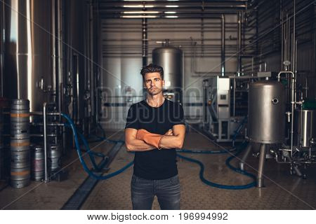 Worker With Industrial Equipment At The Brewery.
