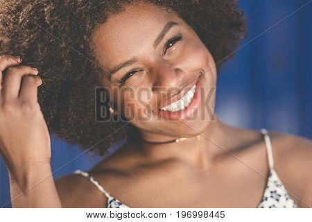 Happy Afro American Woman Tilting Head Holding Hair