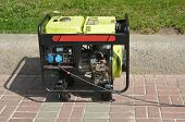 Diesel Portable Generator. Close up on Mobile Diesel Backup Generator. Diesel Standby Generator - Outdoor Power Equipment. poster