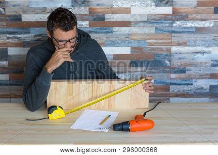 Frustrated Stressed Man Working On House Renovation Project.
