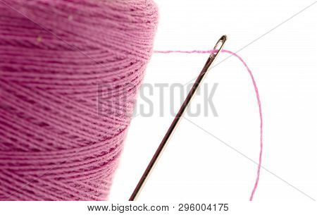 Sewing Thread With Needle Isolated On A White Background