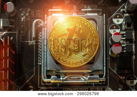 Golden bitcoin among the electronic computer components, business concept of bitcoin digital cryptocurrency. Blockchain technology composition, bitcoin mining concept