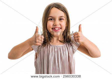 Portrait Of Happy Girl Making Thumbs Up Gesture At Camera.