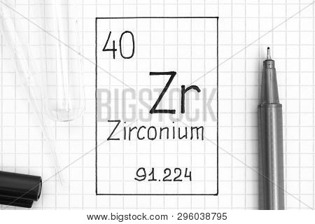 The Periodic table of elements. Handwriting chemical element Zirconium Zr with black pen, test tube and pipette. Close-up. poster