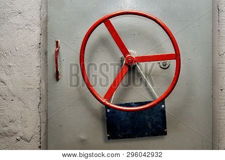Empty Warning Sign Plate Hanging On A Hermetic Bomb Shelter Armored Door