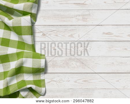 table with grass green picnic cloth top view background