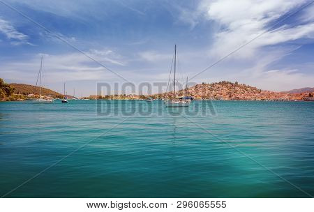 Poros Island In Greece. Panoramic View From The Sea Of Poros Island In Aegean Sea, Greece