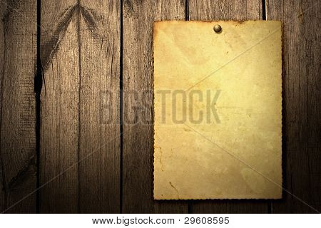 Old vintage poster on wooden background