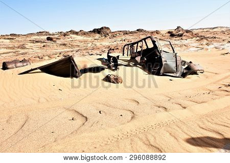 Windblown And, Buried In The Sand Of Sahara - Relict Of The Time Of  The Desert War Between Tschad A