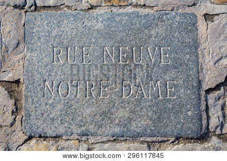 Rue Neuve, Notre-Dame, ancient street sign in the square outside Notre Dame Cathedral in Paris, France. This translates as New Street of Our Lady