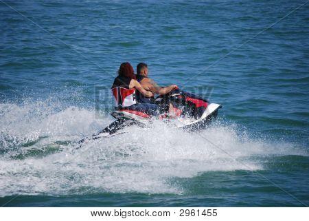 Couple Riding Tandem On A Jetski