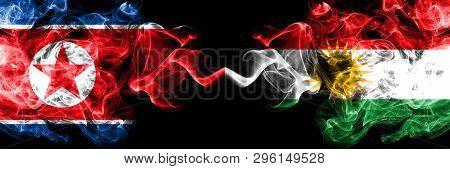 North Korea Vs Kurdistan, Kurdish Smoky Mystic Flags Placed Side By Side. Thick Colored Silky Smoke