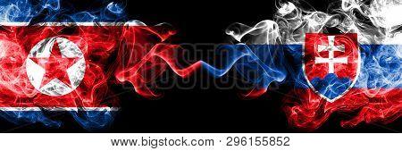 North Korea Vs Slovakia, Slovakian Smoky Mystic Flags Placed Side By Side. Thick Colored Silky Smoke