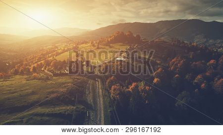 Panoramic Mountain Orange Sunset Countryside Scene. Aerial View. High Mountain Range Highland Rural Landscape. Tourism Concept. Soft Light Unpolluted Environment
