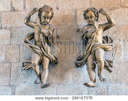 PORTO, PORTUGAL - 3 APRIL, 2019: Two cherubs inside Romanesque Cathedral of Porto, Portugal
