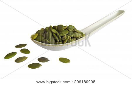 Pumpkin Seeds In The Spoon Isolated On White. Clipping Path Included.