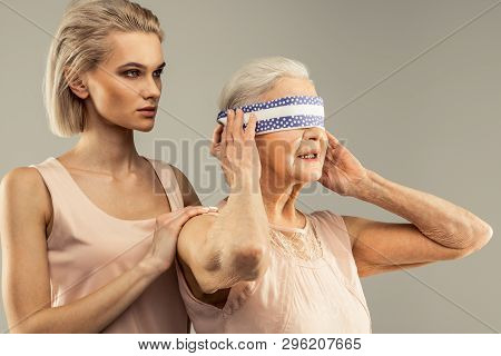 Pleasant Aged Woman Wanting To Open Her Eyes