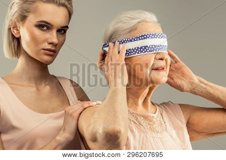 Delighted Nice Aged Woman Touching The Bandage