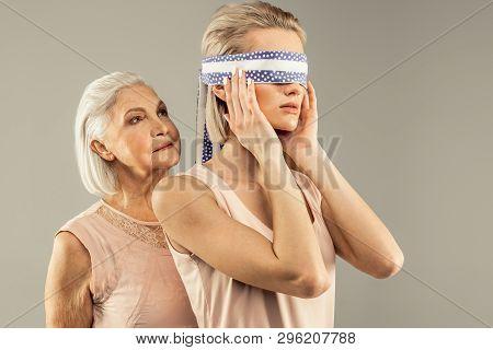Beautiful Young Woman Wearing An Eye Bandage