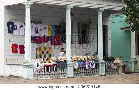Cuba, Santa Clara- February 02, 2013: Souvenir Shop With Straw Hats, T-shirts With A Portrait Of Che