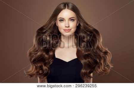 Beauty Girl With Long  And   Shiny Wavy Hair Chocolate Color .  Beautiful   Woman Model With Curly H