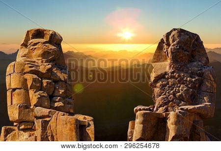 Colossi Of Memnon Luxor Thebes Against The Background Of Dawn In The Mountains