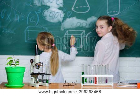 Educational Research. Elementary School Children In Research Laboratory. Microscope And Laboratory E