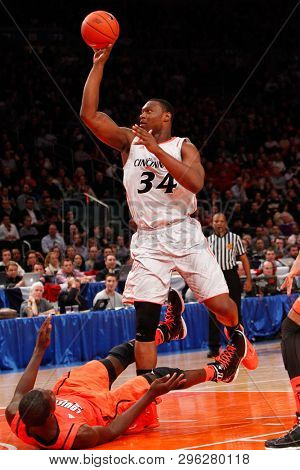 NEW YORK - MAR 10: Cincinnati Bearcats forward Yancy Gates (34) shoots over the Louisville Cardinals during the Big East Tournament on March 10, 2012 at Madison Square Garden in New York City.